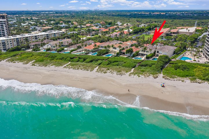 Direct oceanfront home with private beach access in coveted Juno Beach! Located in the exclusive, gated enclave of 700 Ocean Drive, this gorgeous home boasts 5 bedrooms, 7.5 baths, and over 6300 sqft of living space. Details include a two story entry, expansive great room with built-ins & beautiful parquet wood flooring, formal living room with fireplace, downsview kitchen & atrium elevator. The 2nd floor master suite overlooks the ocean with dual master baths & closets, media room and 3 additional guest suites. Oversized balconies off the master bedroom & guest areas contribute to the spectacular outdoor spaces, as well as a covered lanai overlooking the pool, summer kitchen & private access to the beach. This must-see property is a rare opportunity and will not be available long!