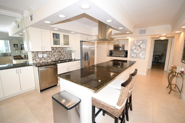 Recently renovated corner unit has an open kitchen / Living area with walls of high impact glass windows to both the south and west to maximize your views of the ocean and wide body of the intracoastal waterway. Enjoy amazing sunsets and the city lights. Large Master with WalkAquarius has a concrete seawall to protect it from the ocean. Wrap around Balcony Furniture Negotiable. Oriental rugs do NOT convey