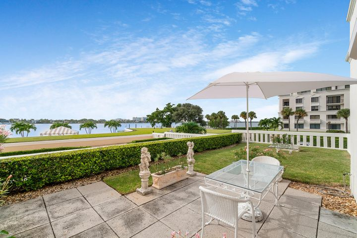 A rarity at the Palm Beach Biltmore! Prime direct lake location with spacious outdoor patio/garden. Ripe for a renovation, this 2/2  is an exciting value opportunity to customize in this five-star Condominium. Amenities include: Beach club, tennis courts, boat dockage, gym, security and more!