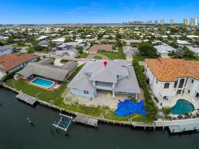 Great Opportunity to own a brand new Singer Island waterfront pool home with room for an 80 foot yacht. Expected completion December 2020. 4 bedrooms plus den/office.  5.5 bathrooms. Home has a light and bright Southern exposure with a short walk to Singer Island's beautiful beaches. Located on one of the best canals on Singer Island and less than 10 minutes to the inlet by boat. Call for more details.
