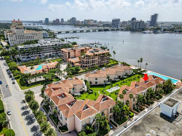 What a great time to own a little piece of Palm Beach Island!  Call today for a private showing of this amazing dream home.  This wonderful townhome is located in Villa Plati just a few feet from the Intracoastal Waterway with spectacular SW views of Flagler Bridge, West Palm Beach skyline, and some of the world's most elegant yachts!  This townhome has a private garage large enough for up to 6 vehicles.  This prime location is about a 5 minute walk to restaurants, Publix and some of the best shopping the island has to offer.  If shopping or dining is not enough, then you are steps away from the pool and the Palm Beach Lake Trail where you can take a leisurely walk, bike ride, jog, or even roller blade.  This 3 bedroom townhome features an oversized patio overlooking the Intracoastal Waterway.  The main level features marble floors with an enormous family room, dining room, and stairwell; oversized kitchen with high end appliances, natural gas cooktop, oven, and marble countertops; office/den; powder room; high ceilings throughout; and elevator.  The upper level features 2 sizable guest bedrooms with private baths; and a large master bedroom and bath with 2 sizable walk in closets, and a private balcony overlooking the Intracoastal!  This home is ready for you to make it your own!