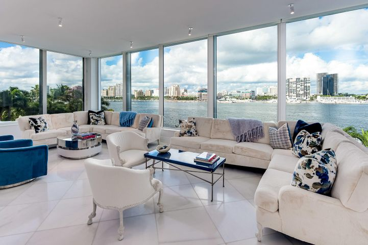 Stunning direct lakefront contemporary apartment with poolside cabana and spectacular Intracoastal views from every room. Custom, pristinely renovated 3 bedroom unit with beautiful marble flooring, high ceilings, dramatic views, and gourmet kitchen. Spacious great room with floor to ceiling windows allows plenty of natural light and incredible sunset and evening city views. The Palm Beach Towers features a fantastic lakefront pool, beautifully landscaped grounds, putting green, health club, salon, Restaurant 44, and more. Located in fantastic In-Town location near The Royal Poinciana Plaza, The Flagler Museum, and The Breakers Golf Course.