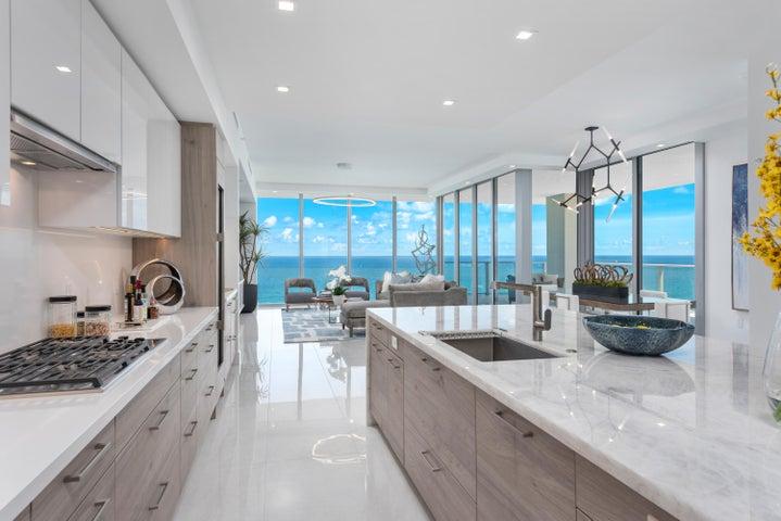 Kitchen with European cabinetry and Cristallo quartzite Island. Pure white quartz counters. Subzero and Wolf Appliances.