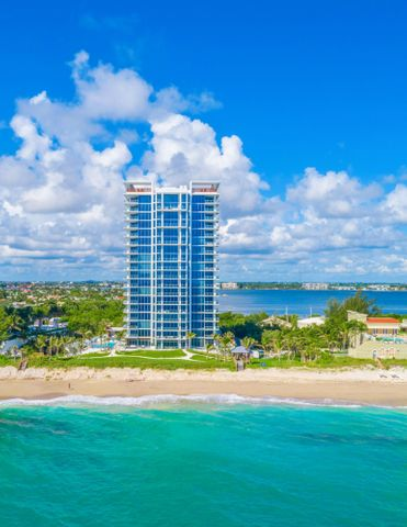 """This one-of-a-kind oceanfront penthouse has 3-beds, 4.5 baths, 3,753 interior sq. ft. & family room.  As one of only 48 residences at the newly completed boutique 5000 North Ocean, a private elevator reveals a flow-through design on the building's top floor. An expansive, southeast terrace offers direct views of the ocean and 340' of Singer Island beachfront.  West-facing terraces provide dramatic Intracoastal views. Includes two assigned garaged parking spaces & climate-controlled storage locker.    5000 North Ocean provides a gracious lobby with full time reception & concierge services, club room, state-of the art fitness center, south facing oceanfront pool with sun all day, a secluded beach & cabana with fireplaces for entertaining.  Pet friendly. Others available. Beautifully finished and delivered furniture-ready with designer coordinated selections. Expansive walls of glass, innovative architectural designs and crisp modern interiors combine to create an unprecedented coastal lifestyle.   Elegant, large format porcelain flooring (24X48) throughout with 8' solid core interior doors.   The designer kitchen features European cabinetry with the latest storage systems and integrated LED lighting. A large Cristallo Quartzite island with waterfall edges, Quartz countertops and full-height backsplashes.  Wolf and Subzero appliances include a 30' refrigerator and 18"""" freezer column, gourmet 5-burner GAS-cooktop with 36"""" retractable Stainless steel canopy hood, under-counter microwave drawer, double wall ovens with warming drawer.  The bar area provides both a wine cooler & beverage center.  Owner's suite includes expansive closet space.  The bath finishes incorporate Lux High Gloss White European cabinetry, Nestos Brown marble countertop, with Grohe fixtures, Kohler sinks, and Toto toilets.  Guest baths appointed with same level finishes.  The laundry room has upper & lower European cabinets with large capacity Electrolux front load washer & dryer."""