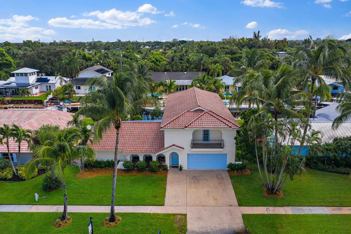 Jupiter Waterfront pool home with 6 bedrooms ( 2 primary rooms, with 1 on each level) and 4 bathrooms.  2 spacious living rooms are split by the kitchen.  Laminate floors in the main living areas and brand new carpeting in bedrooms and upstairs.  For the first time since 1986 this home is ready for a new family to make some life long memories in it.