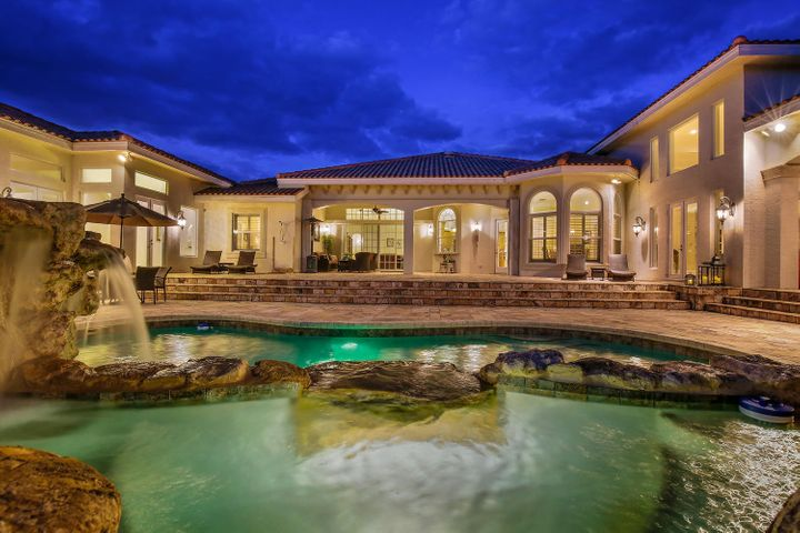 A luxurious mansion awaits you on this private exclusive estate with over 11,000+ sqft under air, 8 bedrooms, 10.5 baths, and an 8 car garage. Embrace the richness of tranquility on your private 20+acre property, with more than 17+ acres of high and dry land. Entertain in a lifestyle most only dream of in the idyllic environs graced by a gorgeous pool, expansive and open dining and lounge covered outdoor areas with kitchen and bar totaling over 17,000+sqft. Endless living possibilities exist embracing eco-rich resources and privacy. Community features include three exclusive and world-renown golf courses, a private airstrip, and equestrian facilities. Ranch Colony is one of the most elite luxuries living communities nationally. Located minutes from the Palm Beaches' fine dining & shopping.