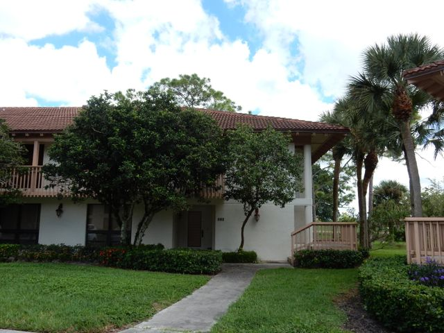 BEAUTIFULLY FURNISHED RENOVATED PREMIUM 1ST FLOOR CORNER UNIT ALL TILE W/WRAP AROUND SCREENED IN LANAI OVERLOOKING THE GOLF COURSE/LAKE. GOLF MEMBERSHIP.