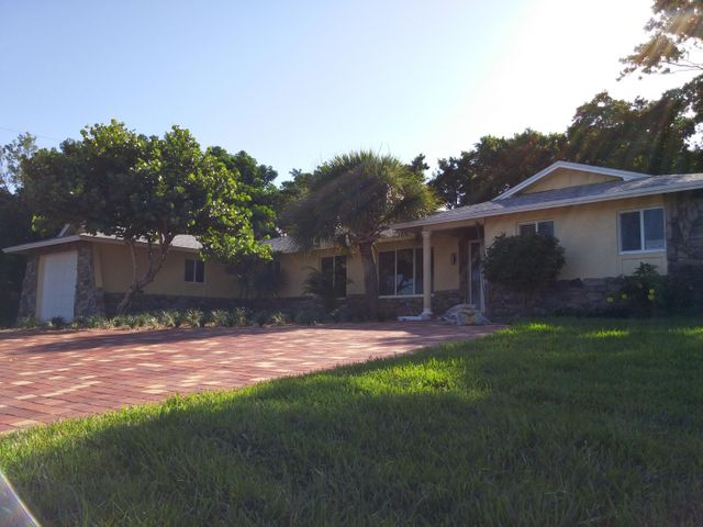 NO HOA restrictions or dues! Recently remodeled kitchen, bathrooms, and flooring. Newly screened pool area with brick paver decking and paver circular drive. Room in back for a nice paver patio too. Glassed enclosed Florida room can be used as a den, home office, gym, etc. Biking/walking distance to the Ocean. Close to Publix and several restaurants.