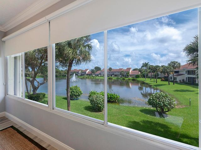 PROFESSIONALLY DECORATED AND RENOVATED IN 2019 WITH GORGEOUS LAKE VIEW, STEPS TO BEACH!  SEA OATS OF JUNO BEACH IS ONE OF THE MOST DESIREABLE LOCATIONS IN JUNO BEACH WITH TENNIS, COMMUNITY POOL AND CLUBHOUSE.  SPECTACULAR WATER VIEWS FROM THIS 2 BEDROOM (EXTENDED FLOORPLAN) CONDO, HIGH CATHEDRAL AND VAULTED CEILINGS WITH CROWN MOLDINGS,  CONTEMPORAY LIGHTING, CEILING FANS.   GORGEOUS KITCHEN WITH SS APPLIANCES, SOFT CLOSE CABINETRY AND PULL OUTS IN PANTRY, ITALIAN MARBLE AND QUARTZITE COUNTER TOPS, DESIGNER BACKSPLASH TILE,  BEAUTIFUL DINING AREA OVERLOOKING LAKE, STUNNING OPEN AND BRIGHT LIVING/GATHERING ROOM CREATES A WONDERFUL LIVING AND ENTERTAINING SPACE!  GUEST BEDROOM IS WONDERFULLY APPOINTED,  PLANTATION SHUTTERS, 1 CAR GARAGE, CLEAN AIR SYSTEM SUPER V  WHOLE HOUSE CLEANER!