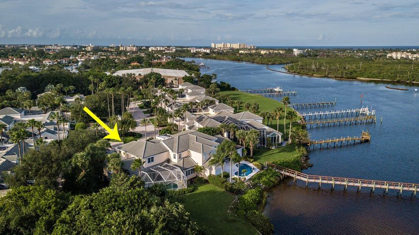 Welcome to Port Dickinson at Jonathan's Landing!  This amazing 2 story home is tucked away on a quiet cut-de-sac,  offering one of the best views of the intracoastal waterway in all of Jupiter. The home is architecturally stunning!  One can easily live in this home with the current floor plan or create your dream home with this perfectly laid out canvas.  With it's grand soaring ceilings, eat-in-kitchen, living room, dining room and great room with a custom built bar looking out onto the Lani with an in-ground pool, entertaining your family and friends will be a snap.  There are 4 bedrooms and 4-1/2 baths, including a large master suite on the first floor. Large two car garage and golf cart garage, plus plenty of driveway for additional parking. Jonathan's Landing Golf Club one would have access to 3 championship golf courses, a premier tennis facility, fitness center with spa, and great fine/casual dining and entertainment