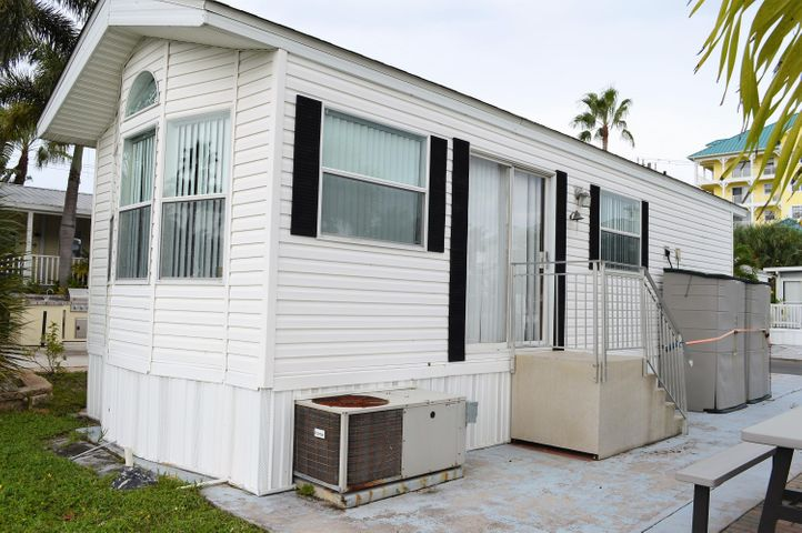 Feel the amazing ocean breezes from your yard. This unit is closest to the Beach and the community clubhouse. A 5-10 minute walk to the Beach and a Publix shopping center. This One bedroom unit is the perfect vacation getaway.