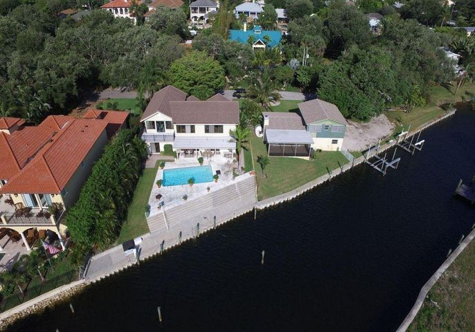Gorgeous, private waterfront property with 235 feet of seawall adjacent to the Intracoastal Waterway on two thirds of an acre at the end of a private tree-lined road. Boater's dream with deep-water for multiple vessels, ocean access & no fixed bridges.  Existing two bed, two and 1/2 bath home sited above flood zone has an updated kitchen/family room and a screened porch with expansive water views.  Boat lift with room for another. Any way you choose this is a unique opportunity to modify or build new on a fabulous waterfront property.