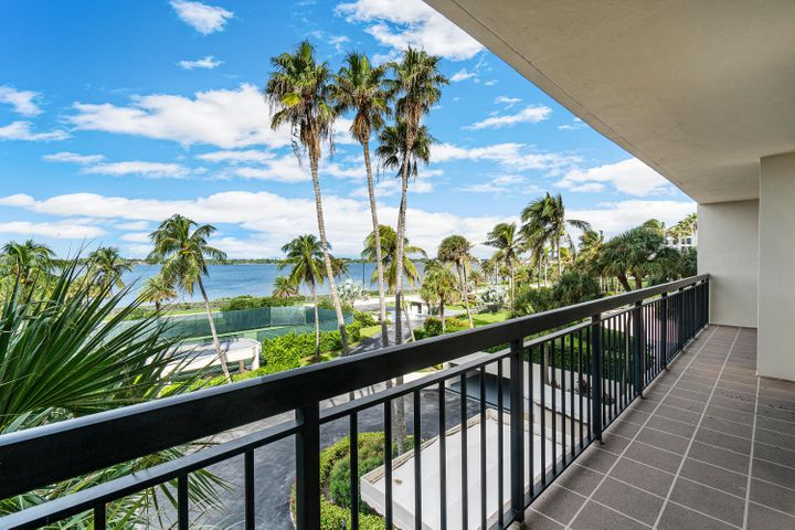 Wonderful views of the Intracoastal from this sun filled southwest corner apartment in the desirable Carlton Place Condominium. Enjoy the sunsets and watch the boats from the large wraparound balcony. Spacious 3 bedroom, 3 bathroom floor plan with water views from every room. A new modern open kitchen, white hurricane doors, porcelain floors in the main living areas, and new air conditioner & water heater make this a move-in apartment. Carlton Place amenities include garage parking for 2 cars, new stylish lobby, hallways, and community rooms, plus a state of the art fitness center and tennis courts. The pool area has a spa and an Oceanfront sundeck leading to the wide beach. Other amenities include 24 hour manned gatehouse and in-season doorperson. Short drive to 5 Star hotels, Palm Beach Par 3 Golf Course, restaurants, Worth Avenue, and cultural centers.