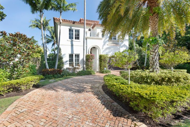A picture of tranquility, this impressive Mediterranean-style villa presides over a beautiful parklike setting of lush tropical landscaping framed by mature trees and stately palms. Providing an elegant welcoming experience, an old brick motor court circles around a lovely garden oasis to the custom arched front door and two-car garage. Offering an abundance of seclusion, the back yard is enclosed within a high privacy wall, and the covered loggia, which features a built-in grill, overlooks the delightful pool and overspill spa, set within an expansive patio, inviting outdoor entertaining and hours of leisurely family living. DISCLAIMER: Information published or otherwise provided by Premier Estate Properties, Inc. and its representatives including but not limited to prices, measurements, square footages, lot sizes, calculations and statistics are deemed reliable but are not guaranteed and are subject to errors, omissions or changes without notice. All such information should be independently verified by any prospective purchaser or seller. Parties should perform their own due diligence to verify such information prior to a sale or listing. Premier Estate Properties, Inc. expressly disclaims any warranty or representation regarding such information. Prices published are either list price, sold price, and/or last asking price. Premier Estate Properties, Inc. participates in the Multiple Listing Service and IDX. The properties published as listed and sold are not necessarily exclusive to Premier Estate Properties, Inc. and may be listed or have sold with other members of the Multiple Listing Service. Transactions where Premier Estate Properties, Inc. represented both buyers and sellers are calculated as two sales. Premier Estate Properties, Inc.'s marketplace is all of the following: Vero Beach, Town of Orchid, Indian River Shores, Town of Palm Beach, West Palm Beach, Manalapan Beach, Point Manalapan, Hypoluxo Island, Ocean Ridge, Gulf Stream, Delray Beach, Highland B