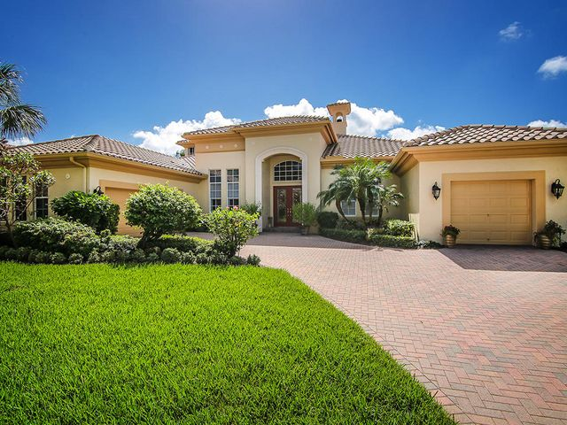 Welcome to 213 SW Palm Cove Drive built by Toll Brothers