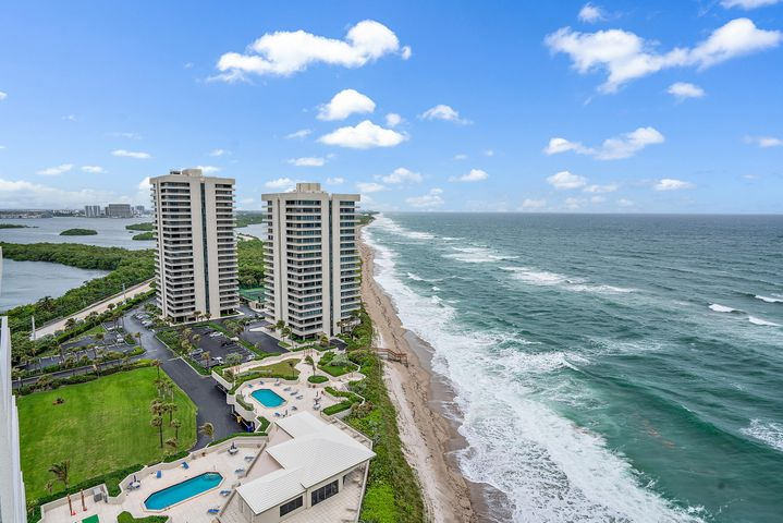 You want Ocean? How about Unobstructed Panoramic Ocean for your entire view from one side to the other in the sought after A stack on the 19th floor. Relax and enjoy the incredible feeling of nothing but Atlantic Blue Ocean as far as you can see. This immaculate two bedroom two bath condo is ready to use or rent. Split bedroom floor plan, floor to ceiling Impact Glass sliding doors, wrap around terrace and covered parking are just a few of the features of this amazing condo. Residents enjoy several amenities including 1,025 feet of private beach frontage, two heated pools, four tennis courts and beautiful recreation deck with a brand-new owner's lounge built in 2014 offering beautiful ocean views. Each building has its own exercise room, library, and extra storage. Water Glades is accessed by a 24-hour manned gate and is adjacent to MacArthur Beach State Park with 438 acres of natural Florida beach, islands and nature preserve.
