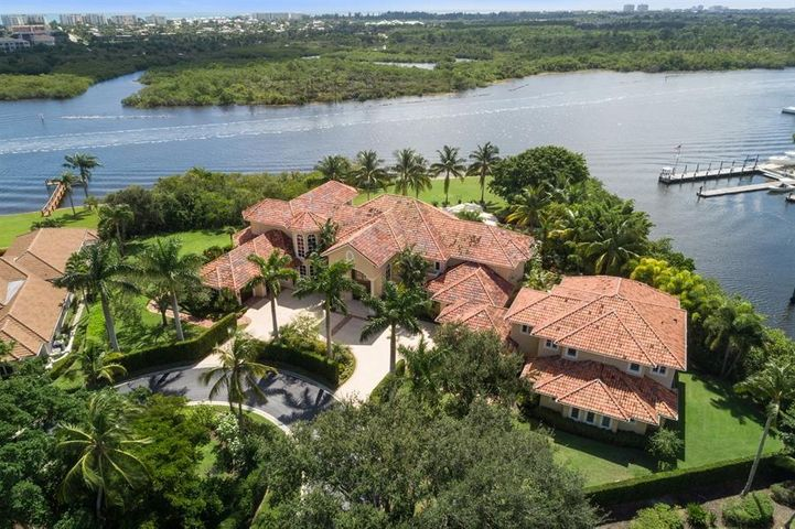 DIRECT INTRACOASTAL Waterfront Estate Smart Home on 1.3 Acres with 315 feet of water-frontage. The updated Main House has 5 bedrooms, 5 full baths, 2 half baths and views of the waterway from almost every room. Dramatic living room with volume ceilings overlook Huge tropical oasis Pool, Rock Waterfall, Jacuzzi for 8 people, wading pool. The chef's kitchen features Viking gas range, 2 ovens, Subzero fridge, 2 dishwashers & 2 sinks. There are 2 wet bars with ice makers, wine fridge, a state of art 10 seat Movie Theater. Separate Guest House built in 2011 has 1 bedroom, 2.5 bathrooms, kitchen with gas range, dishwasher, refrigerator, living & dining area. Private Home Gym with Juice bar, yoga/massage room, spa shower and laundry room. Boat Dock, Marina, Golf Available. Impact Glass, Generator One of kind direct intracoastal waterfront estate Smart Home on point lot surrounded by water and your own private beach area. This magnificent estate was envisioned in grand style. Upon approach, the cul de sac property is lushly landscaped behind large privacy hedges and regal palm trees. The impressive 10 foot solid wood doors open to floor to ceiling glass windows in the waterfront living room with panoramic views. A wet bar and stone fireplace make this the perfect place to entertain. The updated main house boasts 5 in-suite bedrooms. Chef's kitchen features full size Subzero refrigerator and freezer, Viking gas range with 2 ovens, 2 dishwashers, 2 sinks, a pot fill, and a large breakfast room and family room overlooking the waterway. State of the art 10 seat movie theater with power recline seats and power curtains open to reveal a huge movie screen. Fiber optic stars illuminate the ceiling and under lit stairs light the way to seating. The over-sized master bedroom features large walk in closets, Jacuzzi tub, over-sized shower, and private sweeping balcony with southeast views down the intracoastal. The waterfront formal dining room is complimented by exquisite crown moldin