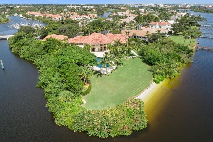 PRICE REDUCED!    DIRECT INTRACOASTAL Waterfront Estate Smart Home on 1.3 ACRES with 315 feet of water-frontage. The updated Main House has 5 bedrooms, 5 full baths, 2 half baths and views of the waterway from almost every room. Dramatic living room with volume ceilings overlook Huge tropical oasis Pool, Rock Waterfall, Jacuzzi for 8 people, wading pool. The chef's kitchen features Viking gas range, 2 ovens, Subzero fridge, 2 dishwashers & 2 sinks. There are 2 wet bars with ice makers, wine fridge, state of art 10 seat Movie Theater. Separate Guest House built in 2011 has 1 bedroom, 2.5 bathrooms, kitchen with gas range, dishwasher, refrigerator, living & dining area. Private Home Gym with Juice bar, massage room, spa shower and laundry room. Impact Windows, Generator. Boat Dock available. One of kind direct intracoastal waterfront estate Smart Home on point lot surrounded by water and your own private beach area. This magnificent estate was envisioned in grand style. Upon approach, the cul de sac property is lushly landscaped behind large privacy hedges and regal palm trees. The impressive 10 foot solid wood doors open to floor to ceiling glass windows in the waterfront living room with panoramic views. A wet bar and stone fireplace make this the perfect place to entertain. The updated main house boasts 5 in-suite bedrooms. Chef's kitchen features full size Subzero refrigerator and freezer, Viking gas range with 2 ovens, 2 dishwashers, 2 sinks, a pot fill, and a large breakfast room and family room overlooking the waterway. State of the art 10 seat movie theater with power recline seats and power curtains open to reveal a huge movie screen. Fiber optic stars illuminate the ceiling and under lit stairs light the way to seating. The over-sized master bedroom features large walk in closets, Jacuzzi tub, over-sized shower, and private sweeping balcony with southeast views down the intracoastal. The waterfront formal dining room is complimented by exquisite crown moldin