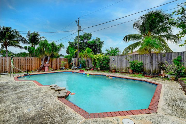 Great opportunity to own this Single Family Pool Home  in EAST BOCA with NO HOA. Available in highly sought after Boca Vista, this property is the perfect fixer upper/starter home, or income producing property. Features over 1,600 living square feet, open den space overlooking the pool,  newer a/c unit, newer water heater, laundry room, ceramic tile in living area. Exterior features screened in porch, fenced backyard, private pool, private shed for extra storage. Side fence backyard opens to driveway for extra parking or boat/RV. Perfectly located by Yamato Rd between I-95 & 2nd Ave. Close to shopping, restaurants, seconds to I-95, 1.5 mile distance to the beach. This is the lowest priced pool home in the area. This opportunity won't last long. Contact listing agent for more information.