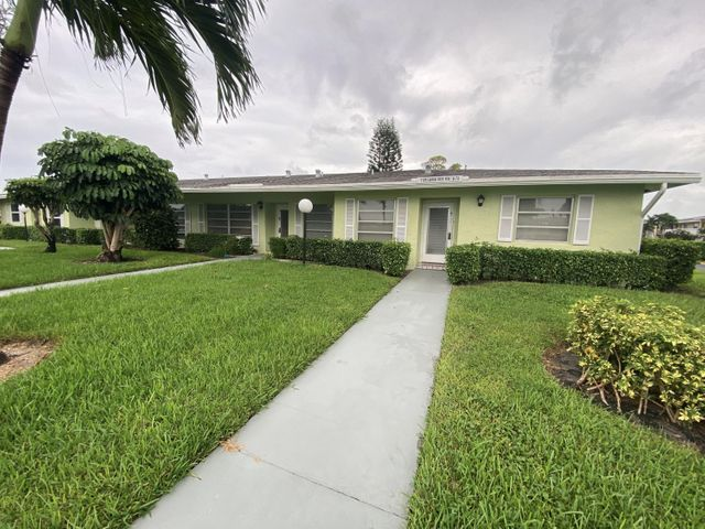 PINES OF DELRAY CORNER VILLA!  2019 renovation!!  Sharp looking  2 bedroom 2 bath one level corner villa and NEWLY FURNISHED as shown. Plus one of the choicest and most  private cul-de-sac location - with southeast exposure onto quiet greenbelt backyard from living room and 120 square foot screened patio. 17 foot long eat-in kitchen with wood cabinetry, tiled backsplash, granite counter tops, 23.6'' x 12'' porcelain tile flooring and 2019 installed stainless steel appliances including 22.1 cuft refrigerator with exterior ice/water, 12 place setting dishwasher, smooth surface range, 1000 Watt 1.6 cuft microwave and Badger 100-1 disposal.  Rheem 2.5 ton/14 seer ac system; Rheem 28 gallon/ 4500 watt water heater; Kohler toilets; updated electrical panel; new vanities .all new lighting.