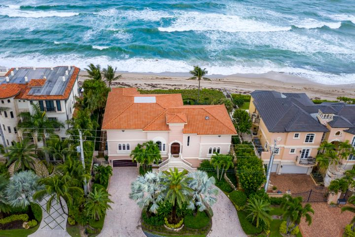 Magnificent Oceanfront Estate in the prestigious Highland Beach resting on 100 feet on the Atlantic Blue Ocean.  Fully built on pilings, 3 year new roof, hurricane impact doors and windows, Italian marble throughout, exotic 6' saltwater fish tank, granite tops in the kitchen, sub-zero refrigerator and freezer, ADT alarm, 3 car garage, whole house 45kw generac oceanside generator, natural gas, 5 air conditioning units mostly under warranty, LED lights, sound system throughout the house, movie theatre, Executive office overlooking the Atlantic blue ocean, 3 story elevator, saltwater pool with travertine marble pool/jacuzzi and new pool heater, whole house water softener and beautiful landscaping. House was designed with all rooms facing the ocean. Interior decorator designed by Steven G Granite top on the bar and fireplace matching granite in kitchen Onyx on tables and powder room Saturnia marble in full lower living area Master bath on 3rd floor with walk-in shower and steam, large Jacuzzi tub with matching sinks Wood floor in master bedroom, 2 walk-in closets Master bedroom balcony new 2 years Direct TV and new wifi in all rooms Custom built-in furniture throughout Formal dining room, full playroom, laundry room newer washer and dryer in utility room Jacuzzi pool has remote wifi controller and new pool heater 2 hot water heaters LED high hats throughout  Fireplace in living room Dream Movie Theatre with 10 foot diagonal drop-down screen Full bar with icemaker, refrigerator and sink Full office with desk and file built-ins, TV and stereo 8 foot solid doors throughout two upper levels One owner, meticulously maintained with no expense spared