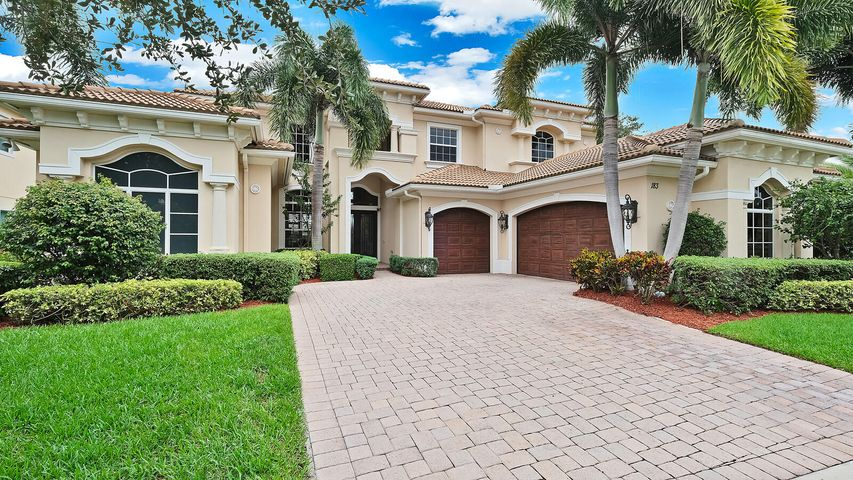 This gorgeous waterfront residence located in the highly desirable gated community of Jupiter Country Club exceeds expectations! The front exterior of this home has a breathtaking entrance, consisting of an oversized pavered driveway, with a double door entry, and a 3 car garage. This property is on .39 acres and boasts an impressive 7,010 total square feet, 5,756 living square feet, 5 bedrooms, 5 full bathrooms, 2 half bathrooms, one of which is a cabana bath, and lake views throughout. Upon entering this beautiful home, you'll fall in love with the 22' vaulted ceilings, floor to ceiling windows, decorative fireplace, and spiral staircase in the formal living room. The stunning kitchen opens up to the breakfast area & family room and has been completely remodeled with custom white... ... cabinetry that have soft-close drawers & doors, a large pantry with pull-out drawers, 3 cm platinum quartz countertops, Wolf stainless steel appliances, Subzero refrigerator, large center island, and additional storage under the stairs. This home comes equipped with a wet bar by the living room, a formal dining room with custom made window treatments, a study, and a media room that include another wet bar and a whole house audio system! The second level has a loft & sitting area that is open to the family & living rooms below and 3 spacious bedrooms that all have walk-in closets and private bathrooms. The large master bedroom suite is perfectly nestled on one side of the home for privacy and features a bay window, private access to the lanai, his & hers walk-in closets, an exercise area, and a spectacular master bathroom with 2 separate toilet rooms, an oversized walk-in shower & separate soak tub and dual sinks with vanity area. The spacious fenced-in backyard has beautiful lake views and includes 2 lanais, cabana bathroom, summer kitchen with an Alfresco grill & sear zone, and a heated freeform pool & spa with a salt chlorination system. Additional features you'll enjoy include, 