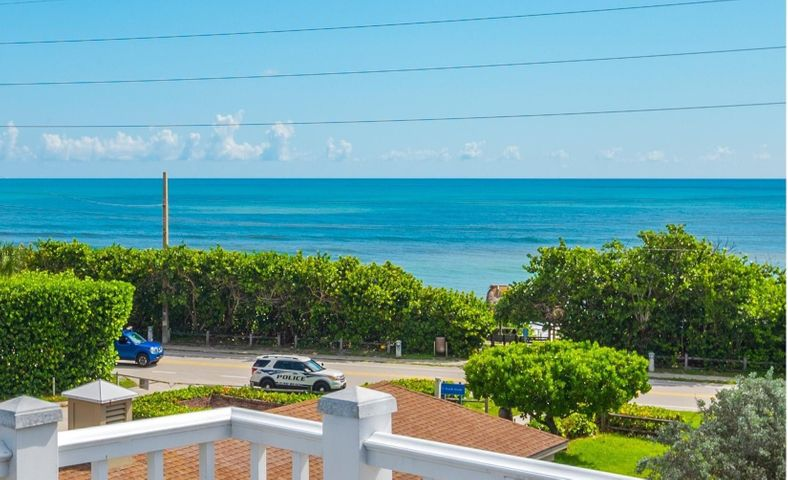 Panoramic Ocean Views from this 3 story Key West Style beach home steps away from the sand of Juno Beach! Rare opportunity to purchase a solid, 2004 built CBS beach home with impact doors & windows (on 2nd & 3rd floors & tempered glass on main level), in prime location in Juno Beach & lots of gorgeous ocean views from 2nd & 3rd floor. This residence features open floor plan with plenty of natural light, crown molding, shiplap wood ceilings, lots mill work, pickled hardwood flooring, Brazilian hardwood exterior decks & swap around patios. The open butcher-block island kitchen offers custom cabinetry, granite counters, SS appliances & stunning ocean views. Step outside into an oversized outdoor decking that is perfect for dining and enjoying beautiful ocean views. Surround sound & an over-sized garage large enough for 2 cars & install car lifts to fit up to 4 cars in garage.   Plenty of storage for all your surfboards & beach gear.  This home has been meticulously maintained by its owner, who recently updated house with 2 New AC units, new Simple water system in house, newer water heater & freshly painted the exterior of the house. Beautiful lush landscaping throughout, & plenty of room for pool, this home offers privacy on no outlet road & no HOA fees.  Enjoy your quiet evenings on the outside balcony overlooking the Atlantic Ocean and listen to the ocean waves crash in the lush tropical landscaping surrounding.   Exceptional location just steps from sandy beaches at Juno Beach, & a short drive to the PGA corridor with world class shopping & restaurants, & only 20 minutes from PBI airport.
