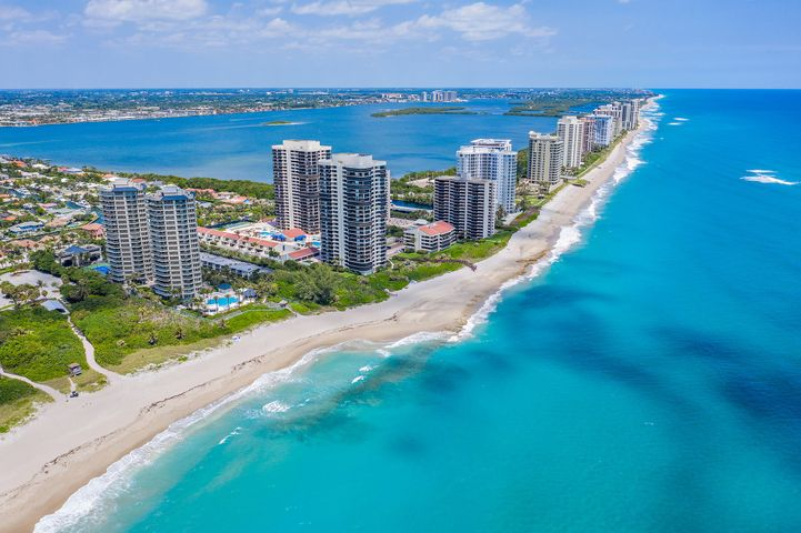After you've spent the day boating, digging your toes in the sand, attending a fishing tournament, or enjoying lunch at the nearby Sailfish Marina, return to your own spacious Singer Island retreat! Conveniently located near the best of everything South Florida lifestyle has to offer, this 3BR/4.5BA CORNER condo has been tastefully appointed & has all you could want in slightly under 2,500SF!!! Custom Poggenpohl kitchen showcasing soft-close cabinetry w/lighting further enhances the Calcutta marble counters/back-splash which adjoins the open floorplan. Finishes include Crown Molding & Travertine Marble flooring in the main areas and wide-plank wood flooring in the bedrooms. One of the only Condos on Singer Island that offer all En-suite bedrooms, rarely found His AND Her Master Baths in Master Bedroom with His & Her HUGE walk-in closets. Floor to ceiling windows offer a tremendous amount of natural sunlight off the large wrap-around balcony. Offering world-class amenities located from over 40,000 sf of pool decking, you have access to both Swimming Pools, Hot Tub/Spa, 24-Hour Concierge, Owners Lounge, Health & Fitness Facility, Library, Billiards Room and the recently renovated Le Club Restaurant for fine dining, BBQ grills for outdoor dining and storage facilities. The ocean/beach is only steps away...what more can you ask for??