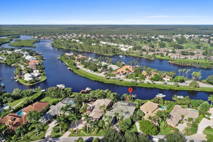 Located in the highly sought after gated community of Jupiter River Estates lies this incredible opportunity to own a beautifully updated home on the Loxahatchee River.  Meticulously maintained, this riverfront home features impact windows and doors, new hardwood flooring throughout, updated kitchen and new baths.  The pool area was made for entertaining with a screened enclosure and a summer kitchen that includes a gas grill, wet bar, built-in ice-maker and a built-in beer keg.  The pool/spa is heated for those cool winter nights.  Out back you will find one of the river's most tranquil canals. The dock includes a 9,000lb lift, fish cleaning station and room for up to a 34ft boat.  Just 20 minutes to the Jupiter Inlet and some of the best snook fishing anywhere in the area.  A must see.