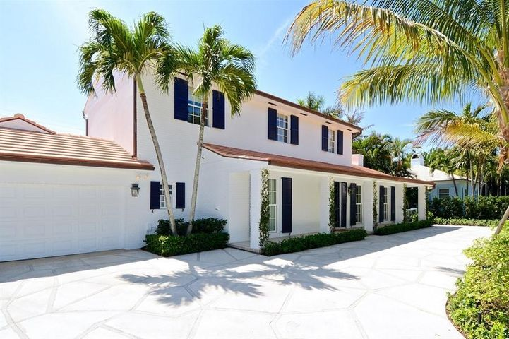 This elegant Palm Beach home is nestled on a private cul-de-sac on the North End. Beautiful south facing exposure and sunny pool area.  A newly renovated kitchen with best in class appliances presiding over a sunny breakfast nook, segues to a stately dining room opening to the outside entertaining area. Features include first floor master suite with his and her bathrooms, formal living room with fireplace, hardwood floors, office, guest bedroom on the first floor and an additional 2 bedrooms upstairs. This home is complete with meticulously manicured grounds and Lake Trail access.