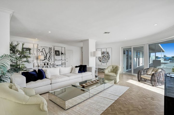 Spacious 3 Bedroom 2 1/2 Bath Apartment with Gracious Outdoor Wrap-around Deck Suitable for Entertaining. Water Views from Deck and Maser Bedroom. Hurricane Impact Windows. Laundry Room. Sliding Doors to Deck from every Room. Prime Poolside Cabana Included.