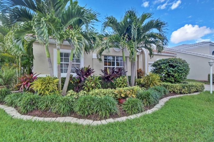 Gorgeous & Meticulously maintained by the original owner! Single level home located on the golf course with a fence and hedge surrounding the pool area for your privacy or you can trim back the hedges to enjoy the tranquil water & golf course views! Two separate gathering places include a TV viewing area and a conversation area. Two eating areas include a formal dining area and a separate, informal table setting. Beautiful, neutral tiled floor and engineered hardwood in the bedrooms. The interior boasts warmly updated bathrooms and kitchen with farm sink and stainless steel appliances. Brand New Samsung washer & dryer duo with steam feature. New light fixtures, and ceiling fans, and warm, subtle, neutral colors throughout. Impact Windows throughout. Roof replaced in 2009. Special attention has been placed to all plantings, from the updated street level landscaping, to the lush potted plants surrounding the pool area. . A/C replaced in 2015. Pool resurfaced in 2015. Newer Hot Water Heater. Two outdoor seating areas surround the pool, a lanai with a retractable screen for outdoor fun and beautiful sunsets! Owners are relocating. Art is not included, but if interested, furniture is negotiable for a quick, no-hassle, turn-key, move-in. Low HOA fees. Country Club membership is not required.  Close to I-95 and Costco.