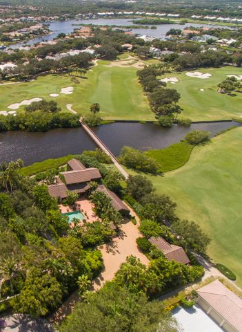 Unique opportunity on a 3/4-acre estate lot to build a 1 story, 10,000 sq. ft. ranch or remodel the existing home and guest house. As 1 of the 10 largest lots in Admirals Cove ON THE WATER, with no house visible across the water way, this presents a terrific opportunity for a builder or homeowner to build the home of their dreams on the most private parcel walking distance to the clubhouse. Spinnaker Lane has less than 18 houses on the entire street and this parcel is at the very end on the cul-de-sac, so there is literally no traffic passing this parcel.