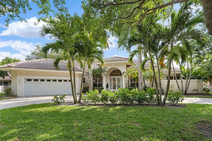 Stunningly renovated, this CBS lakefront one-story home has over 4,100 square feet of living space and is situated on a large lushly landscaped lot in the highly sought after gated community of North Fork in Jupiter. This spectacular home has extensive upgrades including marble, quartz and the most stunning master closet you will ever see-fit for a celebrity, or your most prized possessions. The home features the highly desirable split floor plan with four generously sized bedrooms each with walk in closets and tons of storage PLUS and an office, three full bathrooms and one half bath. A circular paved driveway with mature Royal Palms and tropical landscaping welcomes you to this beautiful lakefront home.  The magnificent glass front doors open to a gorgeous formal foyer and light and bright living room with vaulted high ceilings, featuring diagonally laid quartz tile flooring imported from Italy and clear views of the private lake and backyard paradise.  With exquisite soaring ceilings, rounded archways every meal will be a celebration in the formal dining room. The spacious custom kitchen accommodates less formal meals with counter seating and features Stainless Steel appliances, double wall ovens, marble counters, custom cabinets, gorgeous oversized light fixture and high hat lighting, a large pantry, wine coolers and center marble island.  The kitchen overlooks and seamlessly flows to the  breakfast nook with custom bay windows seats with additional storage underneath all with views of the pool and lake.  The large family room, adjacent to the kitchen, features a real wood burning fireplace.  French doors open to your private backyard sanctuary with Southern exposure wide water lake views and includes covered and uncovered patio areas perfect for entertaining as well as a screened in heated saltwater swimming pool, spa with a custom pool safety fence.   The spacious master suite with mesmerizing lake views and French doors leading to the pool, boasts a custom si