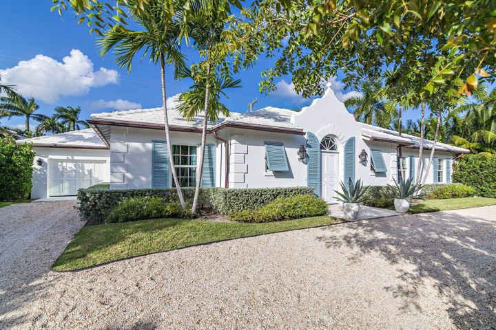 Super Chic Palm Beach Modern Residence. This stunning house was completely renovated and redesigned by renowned architects Richard Sammons & Anne Fairfax in 2018. There are 3 bedrooms, 3 baths and 2 half baths. Interior elements include natural coquina stone floors throughout, pecky cypress beams in the dining loggia, soaring tray ceiling in the living room and multiple sets of French doors leading to the surrounding gardens and terraces. This light filled house is ideal for entertaining with its open modern flow. The outdoors consists of multiple terraces including a covered terrace over looking the pool, set in a lush tropical setting surrounded by palm trees.The property includes a one car garage, exterior outdoor lighting, all new impact windows and doors, new roof, electric & plumbing