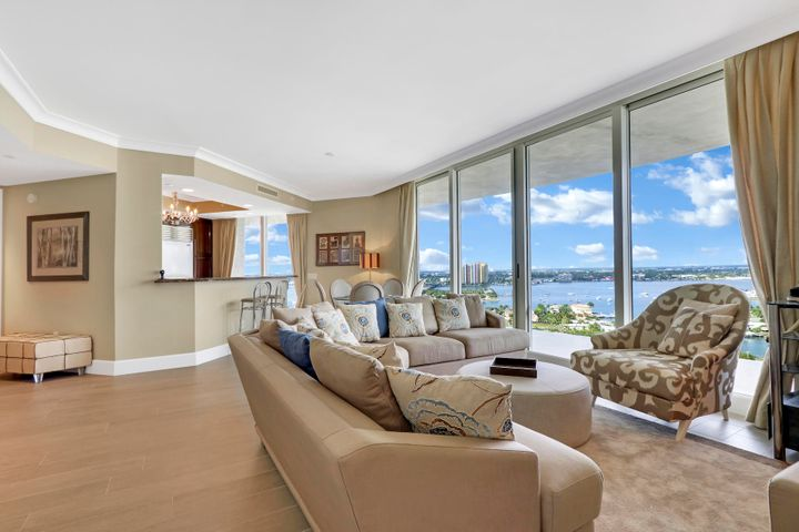 Fall in love with the southwest views watching the boats go by and the magnificent sunsets on Singer Island. Two large bedroom and den facing the waterway. Two private bathrooms plus den/office.  Beautiful gourmet kitchen with breakfast bar. Have lunch at one of the two pools from the private restaurant/grill. Ritz Carlton, well known for their services including concierge, valet, security, mail room.  Nothing is overlooked for the enjoyment of the owners. Located just steps from the Ocean Walk with restaurants and shops, local tennis courts and volley ball area.  Cultural activities abound in the area.  Come an enjoy life at the beach!
