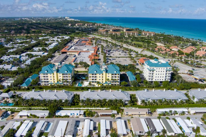 The best unit and location in Juno Ocean Key. Penthouse with 11 foot ceilings in great room overlooking the ocean to the north and to the south. The wraparound balcony faces east and south and keeps the unit bright and cheerful. All hurricane impact windows and sliders, and the largest 1 car detached garage in the complex (handicapped garage). Unit has over $50,000 in option upgrades when built and is very tastefully appointed. Crown moldings throughout, semi private elevator, private foyer, almost 2,100 sq. ft. of living area, open floorplan with split bedrooms and a den that can be used as a third bedroom, office or computer room. A very nice unit for the price and this close to the beach. Walk to the beach, Juno Pier, Publix, banks, and restaurants.
