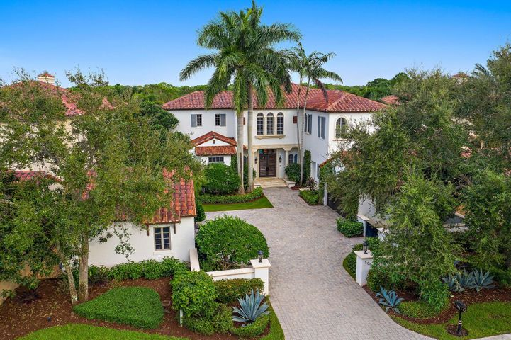 This bright beautiful home is nestled in the highly sought after estate section of the prestigious Trump National Golf Club, Jupiter. This 5 bedroom/ 6.5 bathroom home offers fine detailing and finishes with a transitional flair. A very well maintained home featuring a newly updated gourmet chef's kitchen, 2nd story bonus/media room with custom built-ins, exercise room , 2 laundry rooms, office space, 4 additional bedrooms each with their own ensuite and an expansive first floor master wing with oversized closet space. The lush and very private backyard oasis overlooks the 8th fairway and is complimented with a heated pool, spa and cabana bath. Located just minutes to dining, shopping, entertainment and beautiful beaches. Your own residential coordinator completes this luxury lifestyle