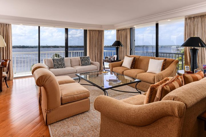 Stunning waterfront condo at the Enclave. Fantastic penthouse corner unit featuring 3 bedrooms, 3 bathrooms, beautiful flooring, and wraparound balcony overlooking the Intracoastal Waterway. Expansive Owner's Suite features built-ins, large bath with dual vanities, walk-in closet, and breathtaking views.