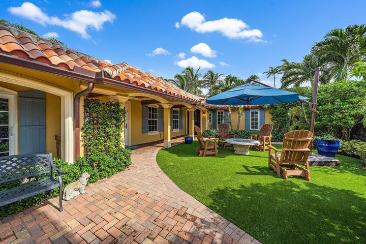 Gorgeous private compound within the gated community of Ocean Walk! Major renovations were done in 2017; kitchen by Waterview Kitchens with gas Wolf stove, impact windows and french doors, gas line to tankless hot water heater, stucco exterior, AC, and flat roof replacement. Three bedrooms with additional office; two and 1/2 baths.  Lovely outdoor space with astroturf in the front courtyard and pavers around the pool in the back. One of the most desirable lots in Ocean Walk and within steps of the ocean!