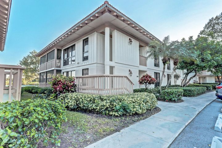 Great views of the lake and the Championship golf course.  2 bedroom, 2 bath, fully furnished.  Community has two pools.  No membership available.  This is a second floor unit.  Available beginning June 2 at off season rates.l. Watch the Honda Classic from your porch!  AVAILABLE FOR SEASON 2022