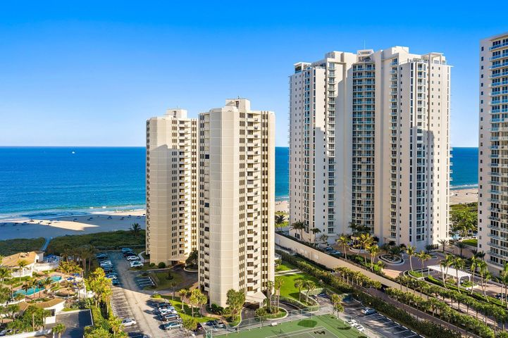 Enjoy Oceanfront living at the Phoenix Towers on Singer Island. This 2 bedroom 2 bath condo offers a beautifully updated kitchen (new refrigerator on it's way), impact glass, 24'' tile throughout, renovated 2nd bath with a split floor plan! The 2nd bedroom functions as the perfect guest suite with a door for added privacy. Two HVAC systems 2019 and 2017. Phoenix Towers has on site property management and offers it's residents private beach access, a heated pool, tennis courts, covered parking, grilling area and much more. Singer Island is home to John D MacArthur State Park, Phil Foster park, Ocean Reef Park and Peanut Island Park. If you love water sports, boating, and exploring nature, you've found the perfect home!! 13 miles from Palm Beach International Airport, and downtown West Palm!