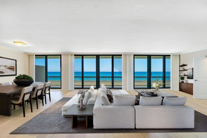Spectacular Direct Ocean Views! Floor to ceiling wrap-around windows allow ocean views from every turn. Coveted South East corner unit. Open floor plan, impact glass and renovated with beautiful bleached oak wood floors, marble bathrooms, new air conditioning unit and new washer and dryer. Neutral palette. Beach Point is a Luxury Oceanfront Full Service Building with 24/7 doorman, fitness center, tennis, garage parking, beautiful pool, Jacuzzi and direct beach access! Enjoy oceanfront resort living in Palm Beach at it's best! Pet friendly, 2 pets allowed with no weight restrictions.