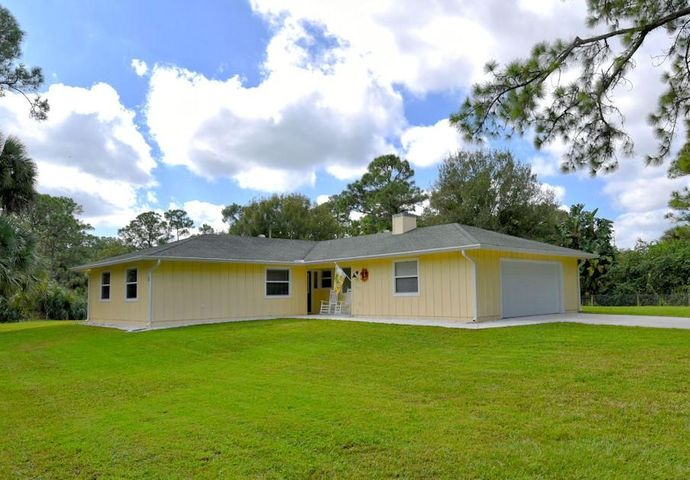 Imagine coming home to this pristine 3 bedroom/2.5 bath ranch with a 2.5 car garage on 1.2 acres of quiet beauty on a paved road on the north side of Jupiter Farms. Relax on your screened in-porch or enjoy a beverage in front of the fireplace. Engineered hardwood floors throughout this impeccably maintained home, impact garage door & PGT windows throughout, updated electric panel with generator hook-up + cable. Stroll your yard with lemon & lime fruit trees & banana trees, and enjoy the walking distance bike/hike paths or nearby River Bend Park. Easy access to I-95/TPike, 15 mins to beaches, amazing restaurant options. Ready to move in and start enjoying Florida lifestyle living!