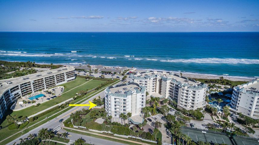 Imagine waking up to an ocean sunrise every morning!  This elegant oceanfront condominium is located in Ocean Grande- Jupiter's premier oceanfront condominium community.  The open floor plan includes three bedrooms, two full baths and a half bath.  The sun filled open concept features a beautiful 'chef ready' kitchen with an eat-in area that overlooks the dining room and spacious living room that opens to an outdoor deck.  The entire area boast beautiful Brazilian wood flooring.  A spacious master bedroom with an oversized master bath, shower, double vanities & walk in closet.  Two additional bedrooms both with private outdoor balcony  and a full bath help round out this condo.  As a bonus, this unit conveys one  of the much sought after (16) private cabanas that surround the  tropical style pool and spa tub.  Jupiter Ocean Grande also features 2- tennis courts, 2 clubhouses with fitness rooms, billiards and kitchen for entertaining.  Lastly, dogs are welcome in this condo and the Jupiter pet-friendly beach is located just across the street.