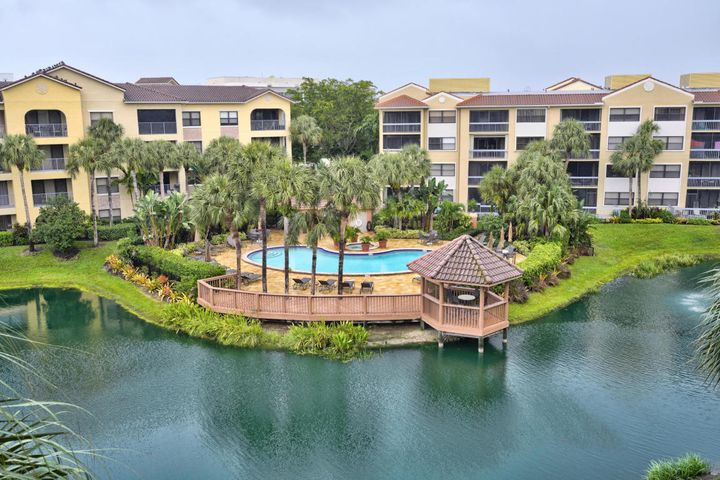 Enjoy Florida Living at its finest in this Tropical Paradise!  3rd floor condo overlooking the lake with spacious screened in balcony! This propety makes for a great investment or 2nd home!  Gated Community has 2 pools, w/jacuzzi tubs, fitness center & picnic area w/outdoor grills! Minutes from the Beaches, Boating, Golf, Downtown Gardens & Restaurants! See Virtual Tour for additional information on the area!