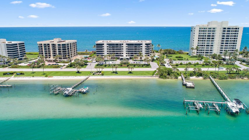 Beautifully renovated, first floor, end unit. Perfect location with oversized balcony that overlooks the ocean, while additional balconies overlook pool and intracoastal.  This unit includes high end appliances, custom cabinetry and built ins, 2 fireplaces, and electric shades. 2 assigned parking spaces in underground garage and storage unit with a/c. The Passages features a renovated lobby with 24 hour manned security. Other amenities include community room, patio grilling area overlooking intracoastal, fitness room, heated pool and spa. A unit like this rarely comes on the market and will not last!