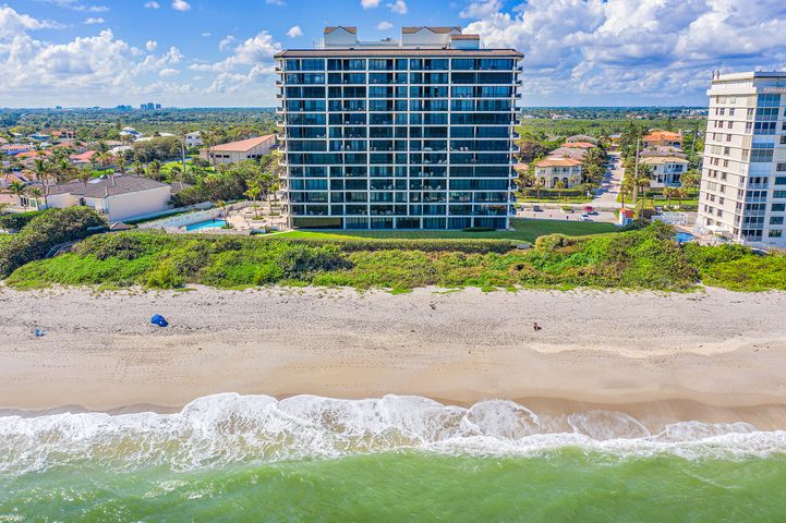 Gorgeous oceanfront DIRECTLY ON THE SAND condominium with huge wrap around balcony in desirable Waterfront Juno Beach! This is luxury living at its best and a perfect opportunity to have a designer decorated furnished condo and start living the ''Salt life''. This home is perfect for entertaining, featuring a large open floorplan with floor to ceiling windows allowing for sunrise and sunset views! The master suite has unparalleled ocean views, spacious walk in closets and a spa like master bath for the most discerning buyer. If that wasn't enough, the private elevator opens directly into the home and a 2 car PRIVATE garage is included. The Waterfront Juno beach is one of the most prestigious buildings offering on site management, fitness center, club room and resort style pool and spa.
