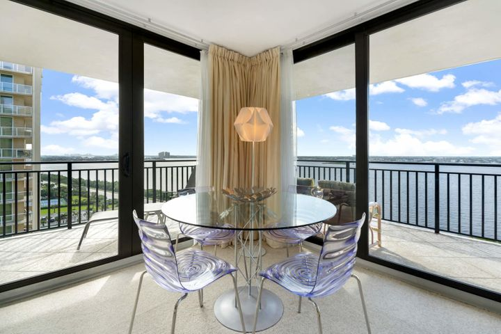Enjoy this light and airy condo with wide open beautiful views of the Intracoastal Waterway and the Atlantic Ocean. Seagrape sits directly on the sand so you can enjoy your coffee on the beach watching the sunrise, then sit on your wrap around balcony in the evening looking at the sunset. This spacious condo has two large bedrooms both with walk in closets and on suite baths. Light colored wood cabinetry throughout with a neutral tile in main living areas. With only 4 units per floor you have the privacy you want or go enjoy the amenities with your neighbors. Includes garage parking. Seagrape, with only 60 private residences, is located at the north end of Singer Island just a short walk from MacArthur State Park. Amenities include a casual heated pool and spa, owner's club room, tennis court, exercise room, hurricane impact glass sliding doors, split bedroom floor plans, on site manager and private beach access. Monthly maintenance fee includes Home Warranty Service Contract.