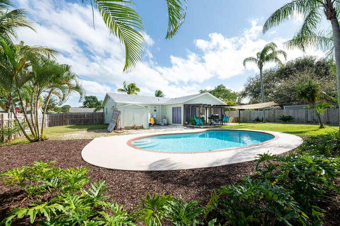WOW!!! RENOVATED POOL HOME IN JUPITER WITH NO HOA!!! Entire home was recently renovated to include new roof, HVAC, hot water heater, kitchen, kitchen appliances, flooring, pool pump, bathrooms etc. all completed within the last 2 years!! Don't miss this rare gem in Jupiter! Oversized backyard, completely fenced in! NO HOA = NO RESTRICTIONS! Bring your trucks, RV, and Boats! Pool converted to Salt Water in 2020, recently finished with ''Diamond Bright'' and newer pool pump!  Renovated kitchen features granite counters and subway tile backsplash for an awesome coastal-chic design + decor. Additional den/family room with awesome views to your private backyard oasis; perfect for a home office and/or dining room. No garage.  Don't wait- won't last!